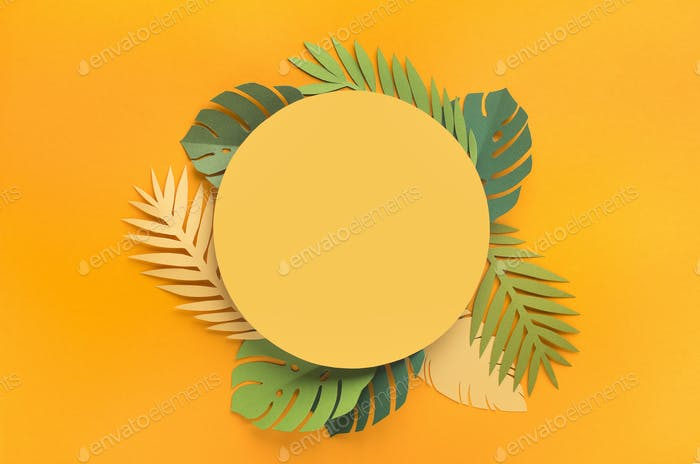 Summer background with green tropical leaves around yellow blank place