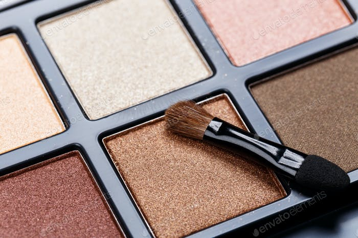 Black palette of colorful eye shadows