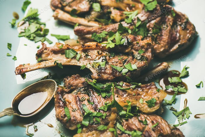 Grilled lamb ribs with green parsley and sauce, meat dinner