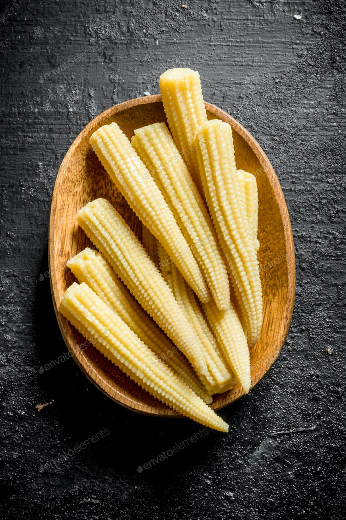 Preserved corn on a plate.