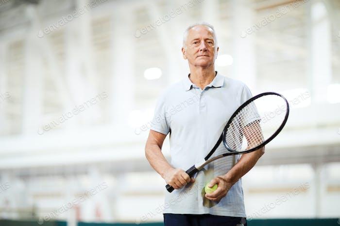 Tennis player in sports center