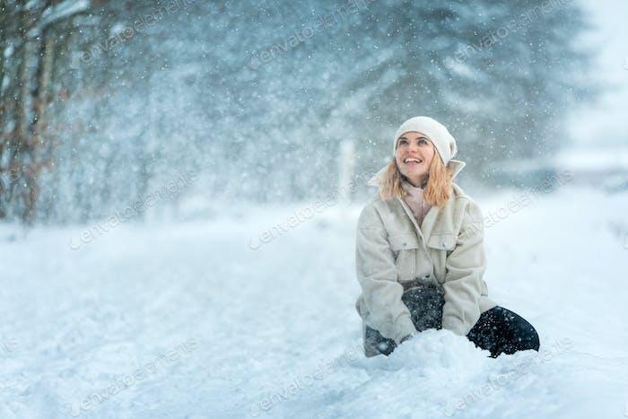 Beautiful girl in amazing snowy land