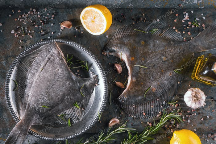 Raw flounder with different seasoning on stone