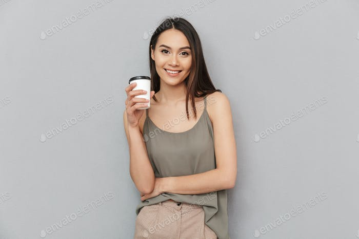 Portrait of a lovely asian woman take away coffee cup
