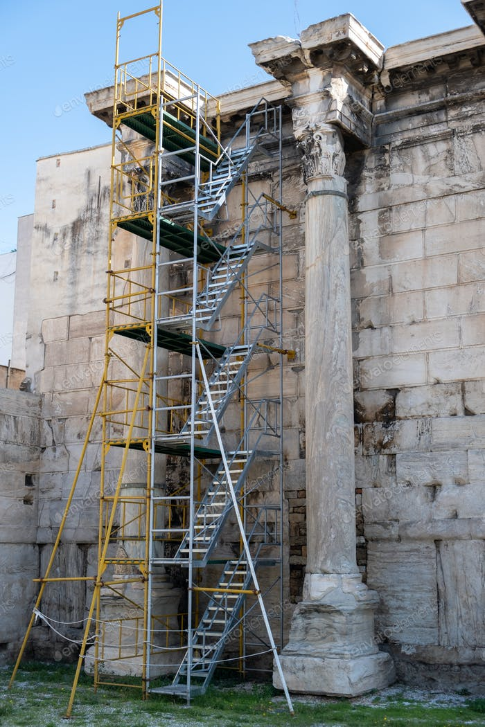 Hadrians library columns scaffolded for restoration works, blue sky background