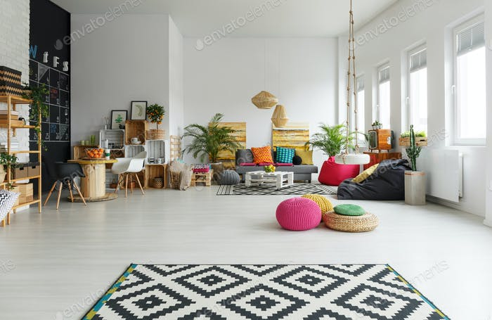 White room with colorful pouf