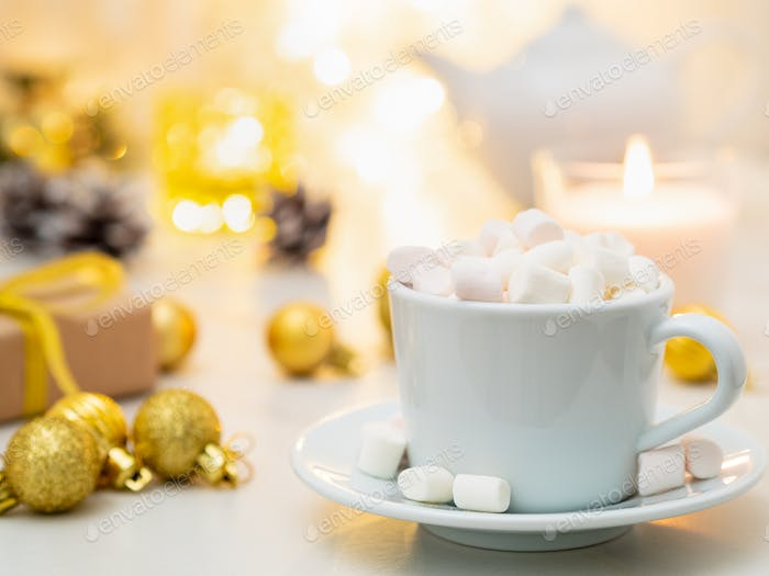 Cozy evening, cup of drink, Christmas decorations, candles and lights garlands