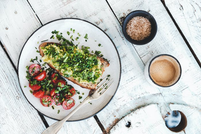 Healthy Vegan meal with avocado toast and coffee, top view