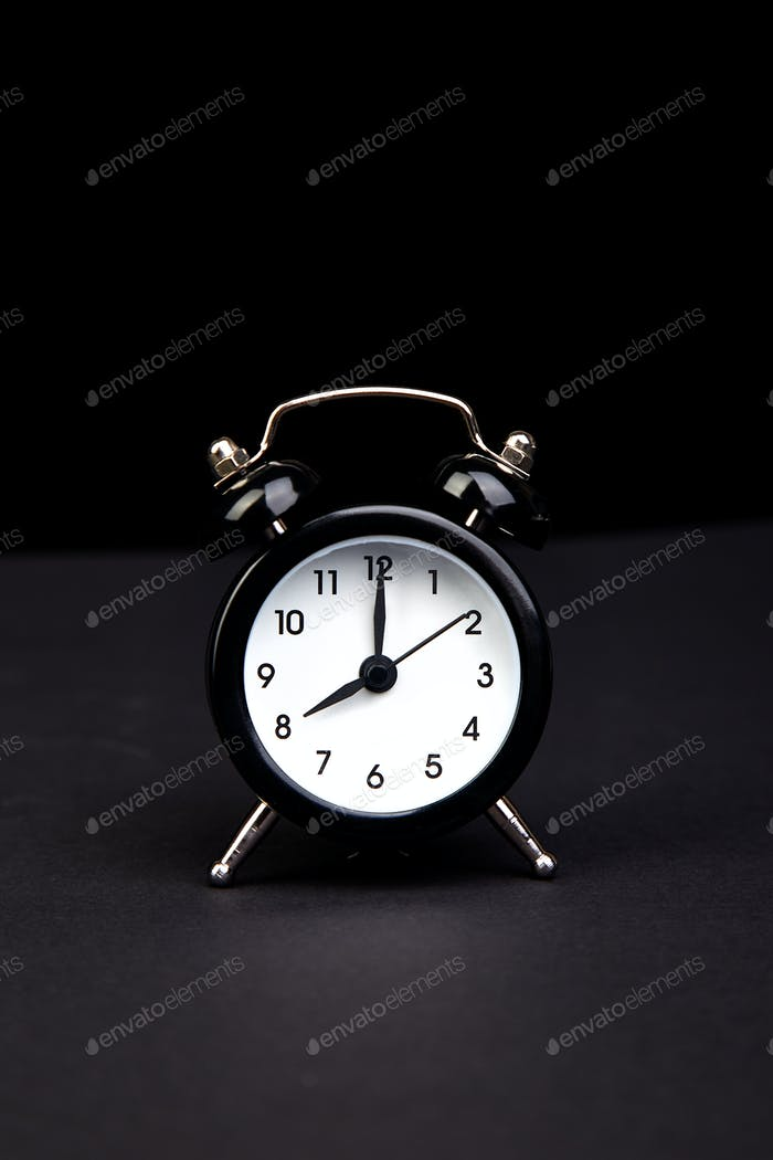 Black vintage alarm  clock.