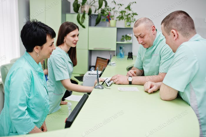Medical theme. Group of doctors meeting at reception of diagnostic center in hospital.