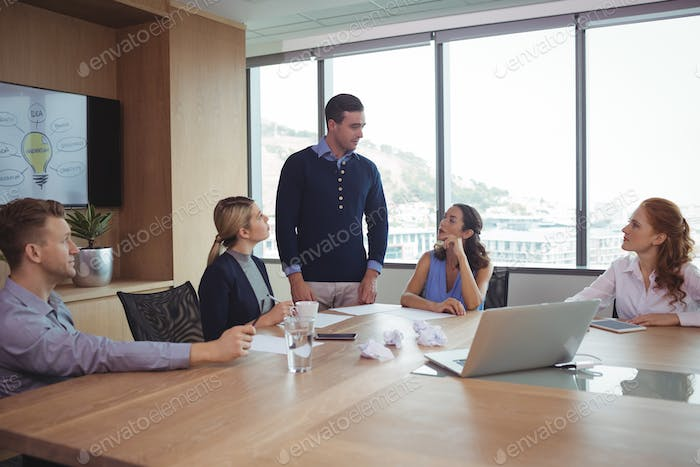 Business partners discussing in meeting at office