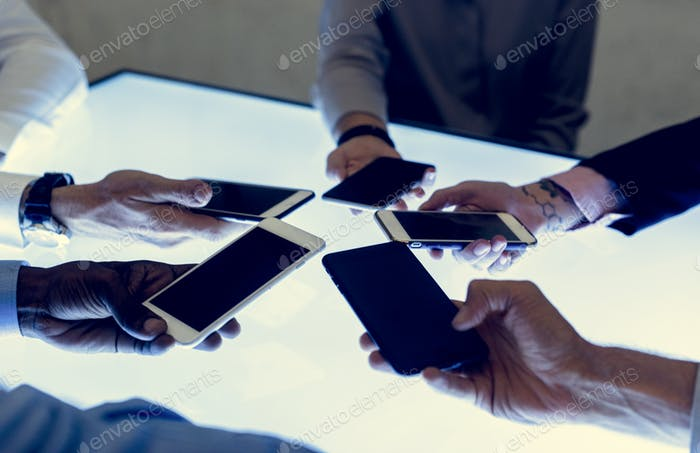 People in a meeting using smartphone