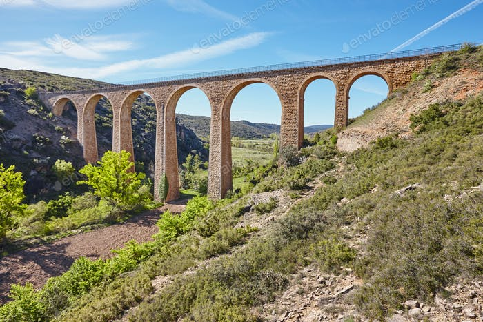 Stone viaduct in Albentosa, Teruel. Spain. Green way. Architecture