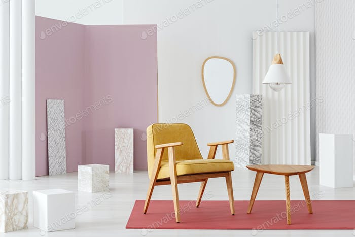 Mustard armchair by table