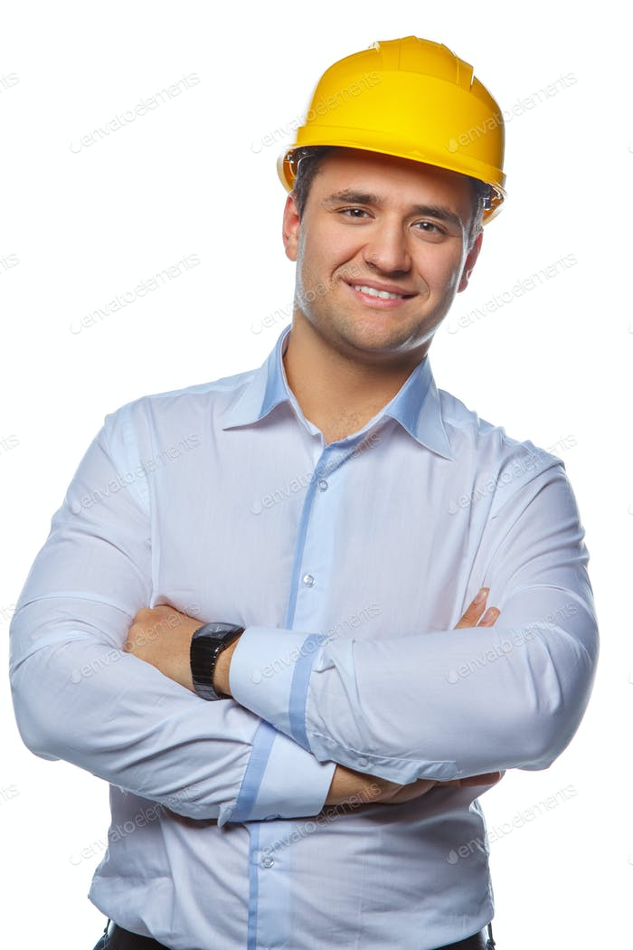 Portrait of positive worker male in yellow safe helmet.