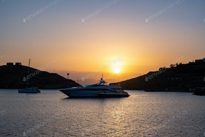 Yacht, luxury boat on calm sea at sunset in the Aegean sea, Greece, Kea island.