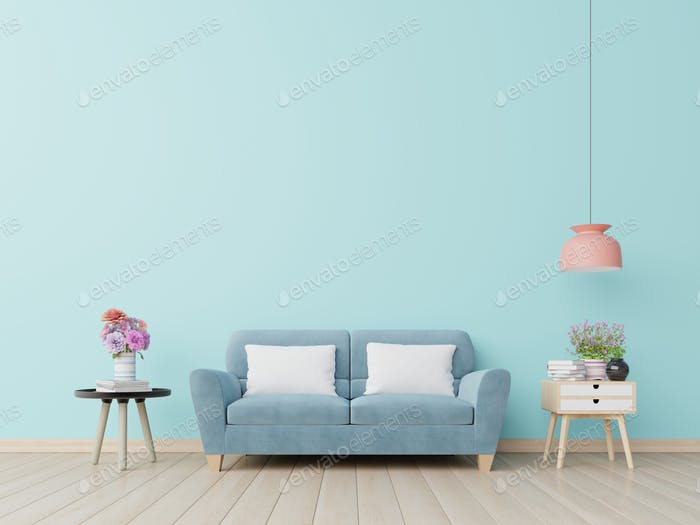 Blue wall living room with blue sofa.