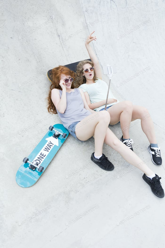 Two young girls on the vert ramp