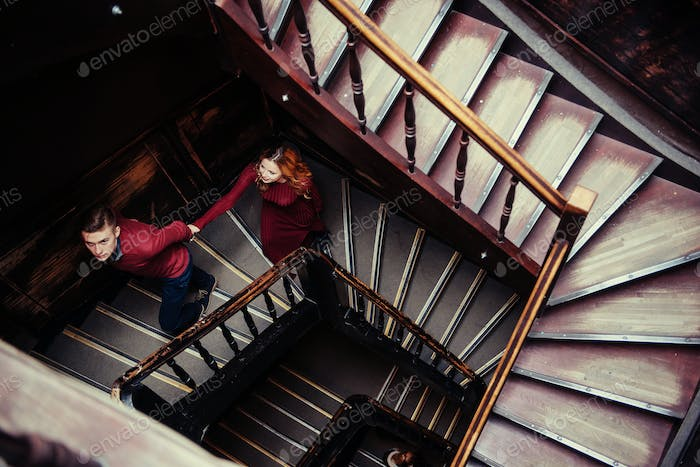 couple of young people on the wooden stairs