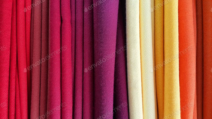 Bright multicolored background of fabrics