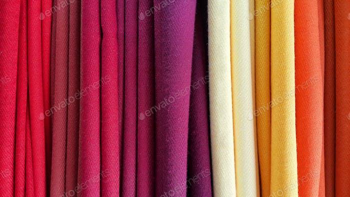 Bright multicolored background of fabrics