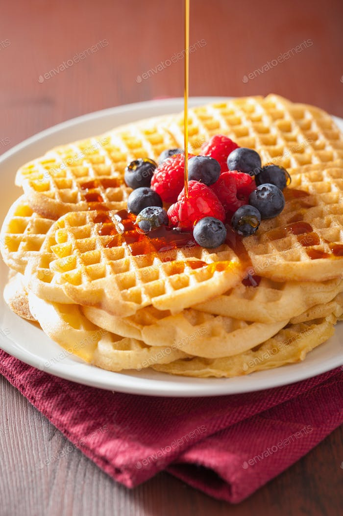 waffles with caramel sauce and berries for breakfast