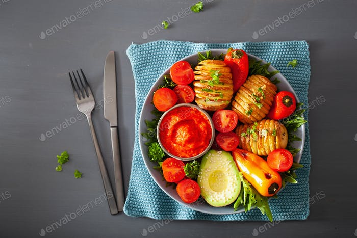vegan buddha bowl. healthy lunch bowl with hasselback potato, av