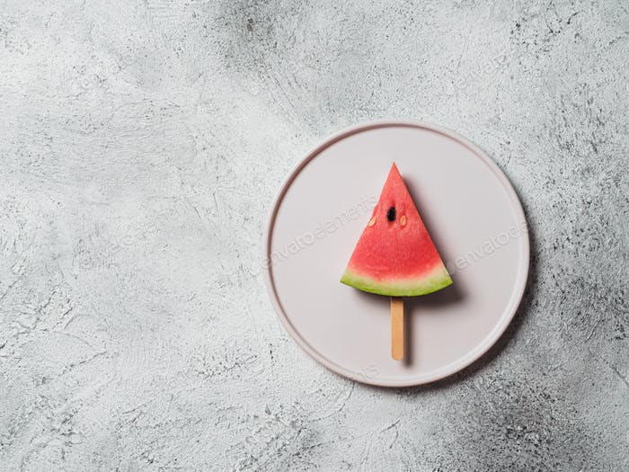 watermelon popsicle on gray