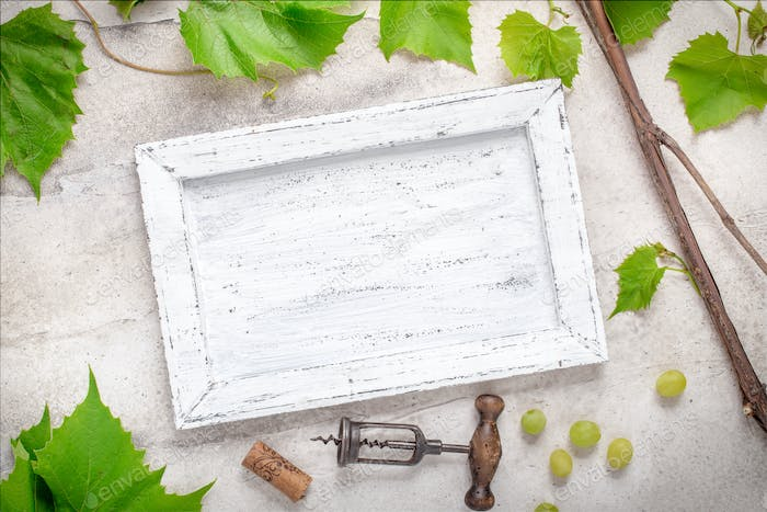 White frame with grape branches
