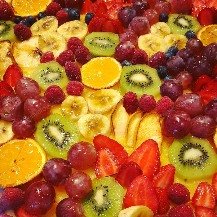 Holiday cake with fruits and berries, close-up food background
