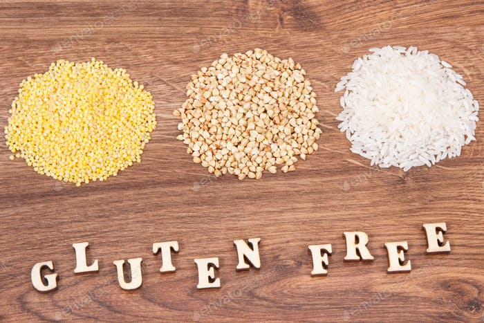 Inscription gluten free with millet groats, white buckwheat and rice, healthy food concept