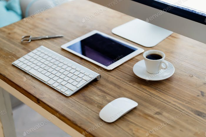 Picture of office desk with tablet computer and other accessories