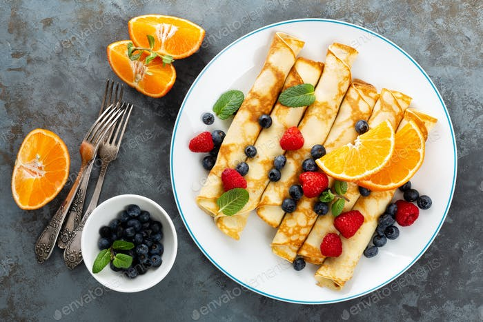 Sweet pancakes wrapped with fresh berries