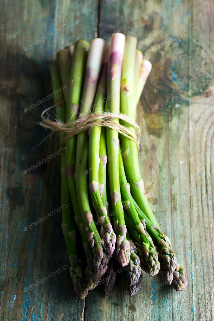 Freshly picked natural organic asparagus bunch on wooden background