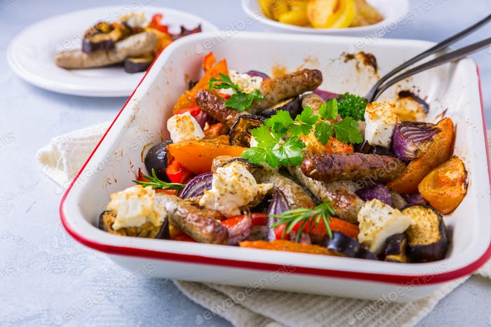 Roasted sausages with vegetables and feta cheese