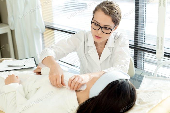 Beautiful Nurse Preparing Woman for Treatment