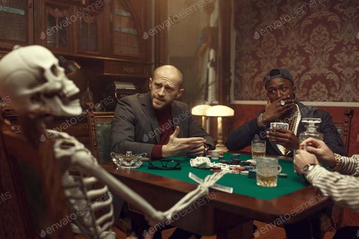 Poker players and skeleton at gaming table, fun