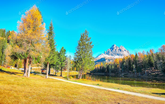 Astonishing view of popular travel destination mountain lake Antorno in autumn