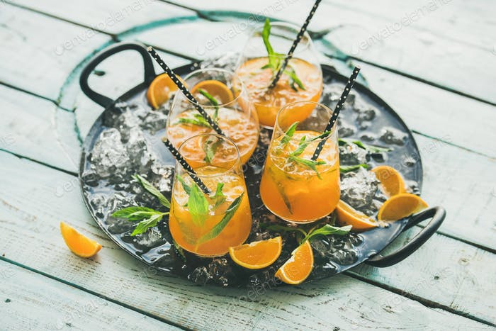 Refreshing alcoholic summer cocktail in glasses on tray