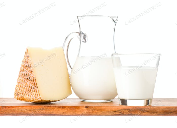cheese and milk on wood