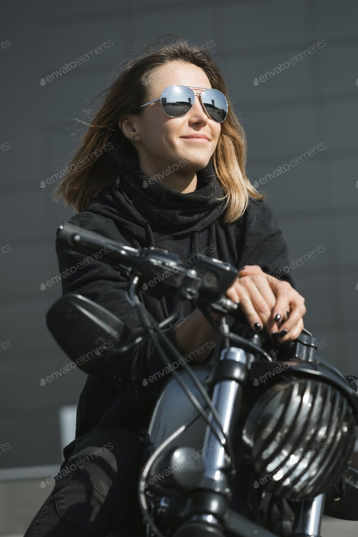 biker woman sitting on motorcycle