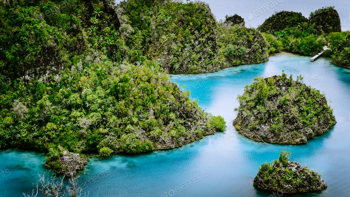 Pianemo Islands, Blue Lagoon with Green Rocks, Raja Ampat, West Papua. Indonesia