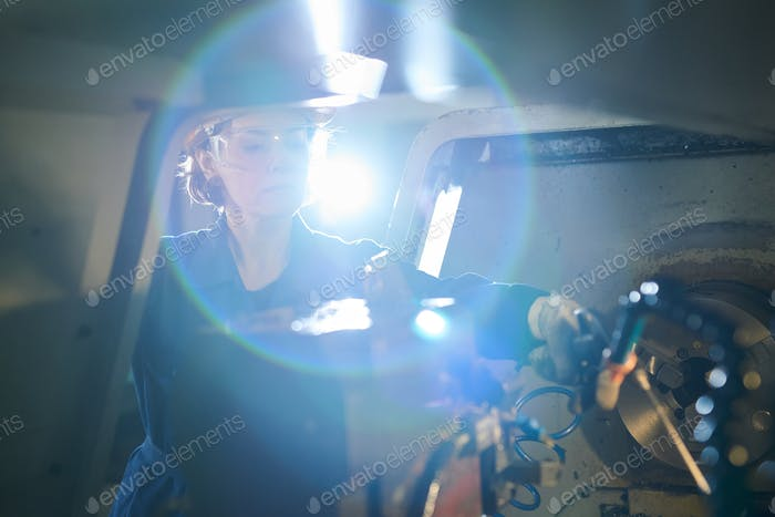 Female Worker at Factory Lens Flare
