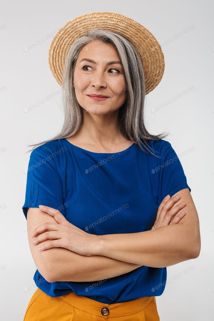 Image of adult mature woman with long gray hair wearing straw summer hat