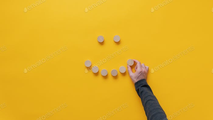 Making a smiling face of blank wooden cut circles