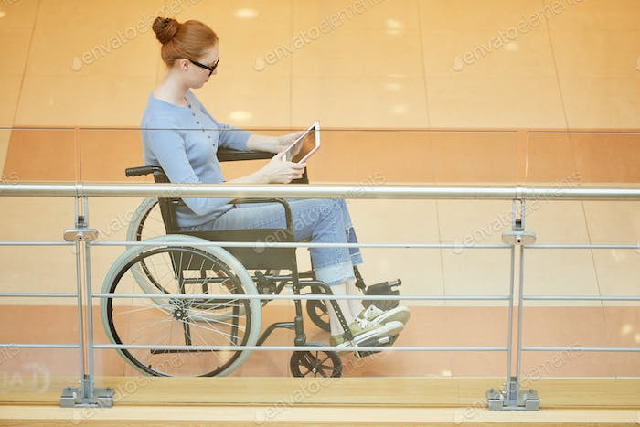 Disabled woman using tablet pc