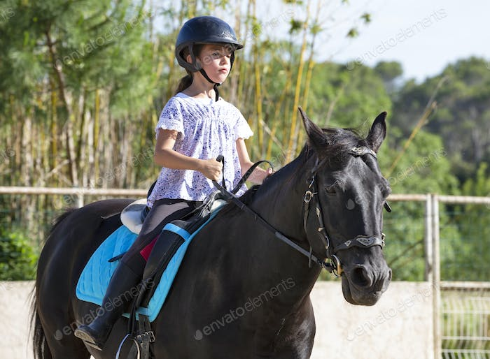 riding child and horse