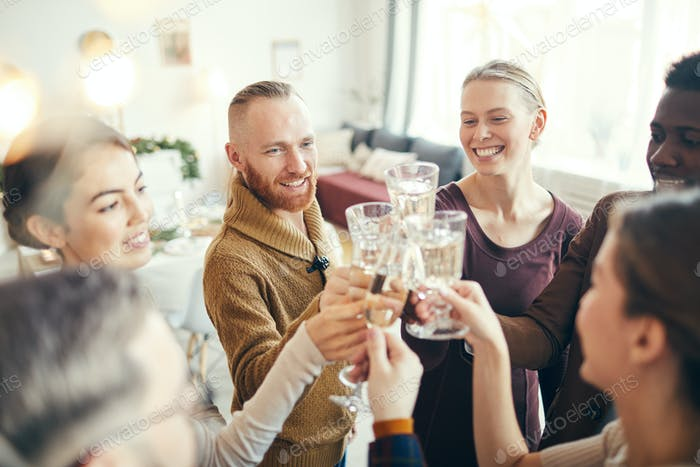 People Toasting at Christmas Party