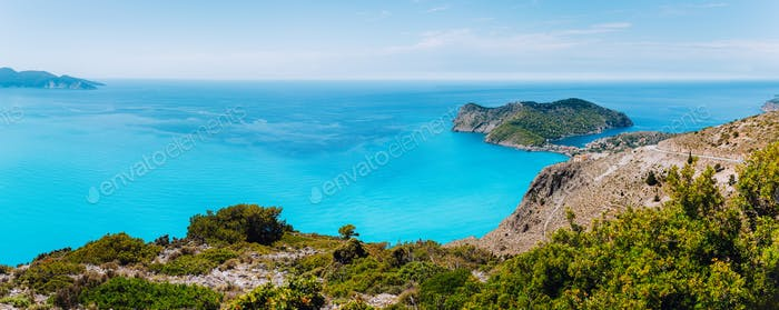 Panoramic shot of Frourio peninsular with cute Assos village surrounded by beautiful blue sea