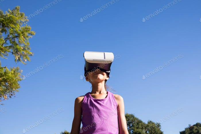 Girl using vr headset in the park